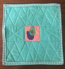 Avocado quilt in pink and mint green