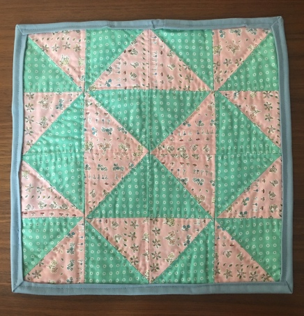 Half square triangle mini quilt with pink and mint green