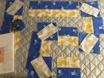 Ironing and rough measuring fabric pieces for the quilt