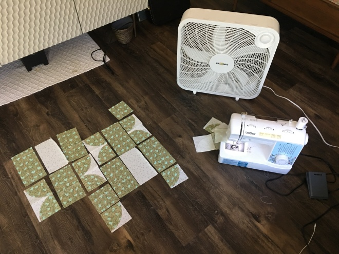 Living room floor quilting layout on a hot day